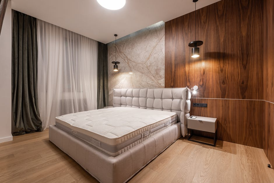 A double bed with a wooden floor
